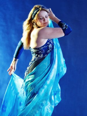 Known professionally as Shira, Iowa City's Julie Elliot models a more conservative form of belly-dancing costume, as opposed to the midriff-baring kind most people associate with the art.