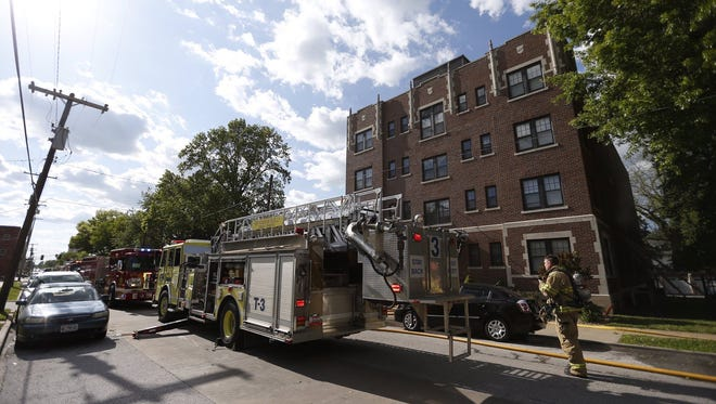 Firefighters responding to a fire at the Ambassador Apartments on Thursday.
