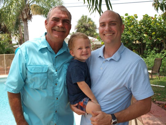 Neal and his dad with 2-year-old  Brody. Tingler hopes Brody, and a son expected in August, will be able to enjoy the life he relished as a child born in 1977.