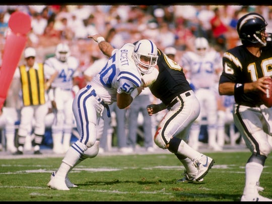 Linebacker Duane Bickett of the Indianapolis Colts (left) in action during a game against the San Diego Chargers at Jack Murphy Stadium in San Diego, California.