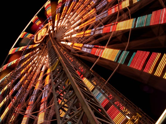 The Ferris wheel on the midway at the Ozark Empire