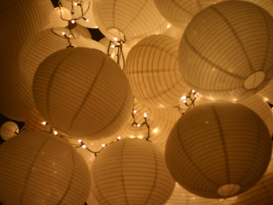Libby Castro reuses lanterns from her wedding to create a Christmas tree-like sculpture in her home.