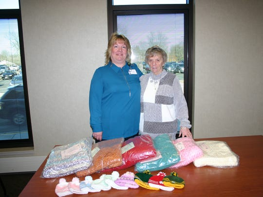 Barb Peeters (left) chairs the Baby Cap Committee and