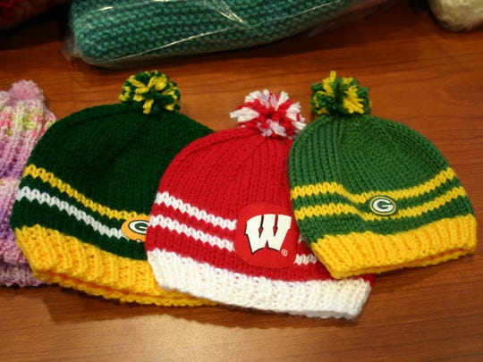 Some of the more popular baby caps sport Green Bay Packers and UW-Madison logos.