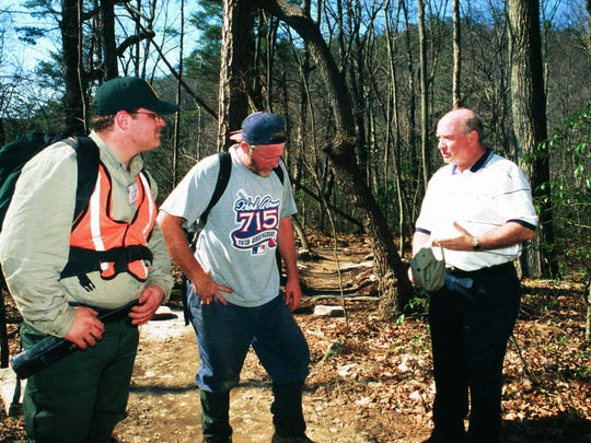 Ranger Andy Wright, left, and park volunteer Carl Turner