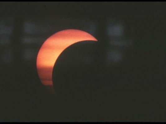 Partial eclipse,seen through clouds, taken through solar filter on a telescope