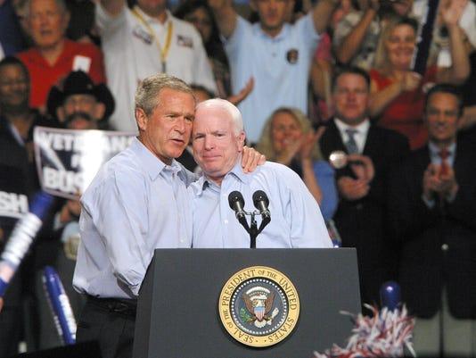 John McCain and George W. Bush