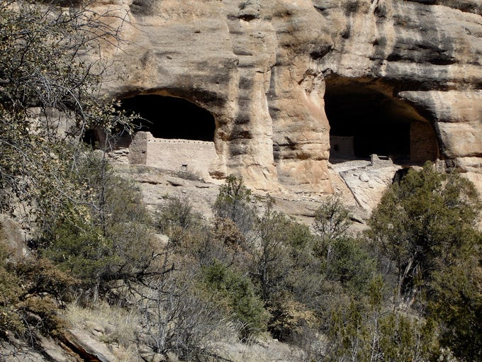 The Gila Cliff Dwellings nestled beneath shelf of volcanic