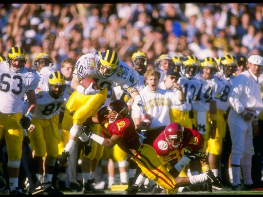 John Kolesar escapes a USC tackler during Michigan's 22-14 win over the Trojans during the Rose Bowl on Jan. 2, 1989.