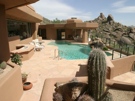 A 7,000-square-foot home built into side of Black Mountain across from Boulders Resort.