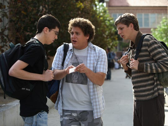 "Christopher Mintz-Plasse (from left), Jonah Hill and Michael Cera play characters on a hunt for alcohol in the 2007 Judd Apatow film ""Superbad.""."