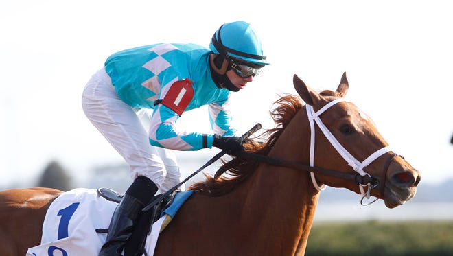 Florent Geroux aboard Monomoy Girl wins the Ashland Stakes at Keeneland Racecourse on April 7.