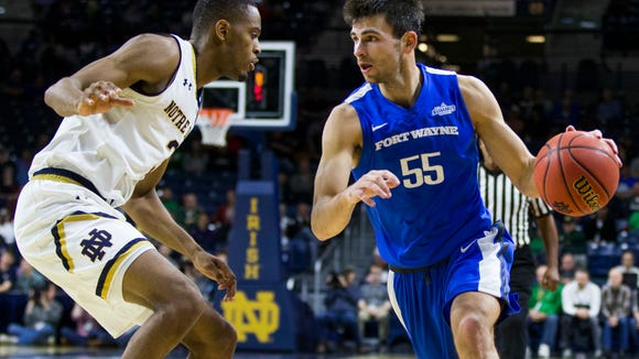 IPFW's JohnKonchar (55) drives next to Notre Dame's V.J. Beachem (3) during an NCAA college basketball game Tuesday, Dec. 6, 2016, in South Bend, Ind. Notre Dame beat IPFW 87-72. (AP Photo/Robert Franklin)