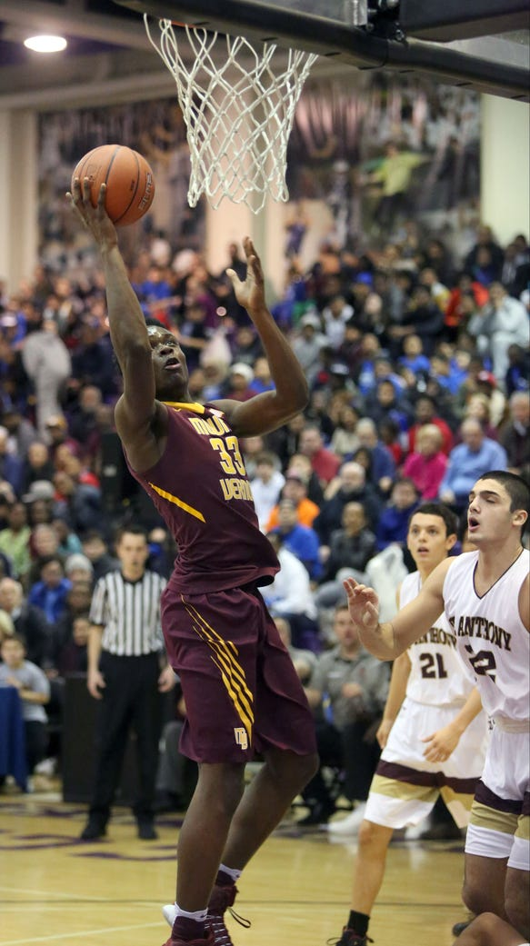 Mount Vernon's Gregory Calixte goes up for a shot in