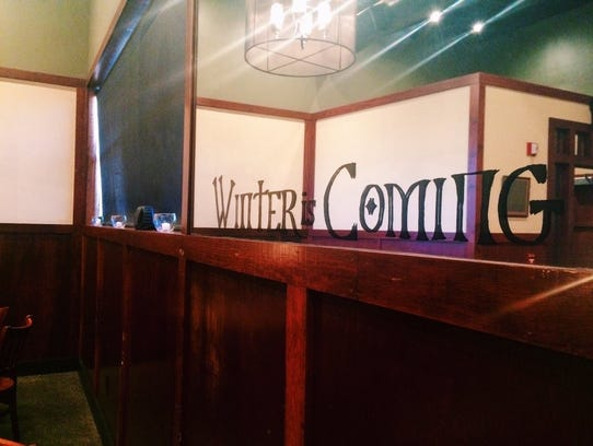 Staff decorates Iron Hill Brewery in Newark for its