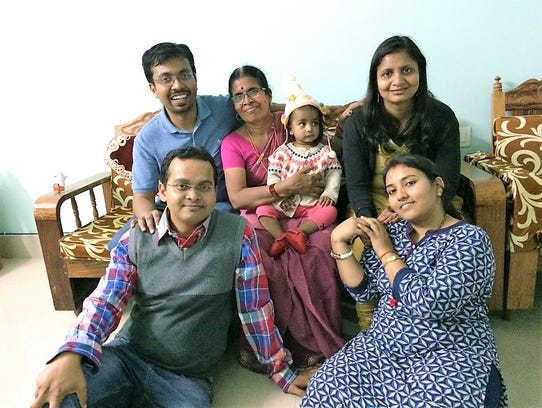 Praveen Sinha, front left, with his brother, Naveen,
