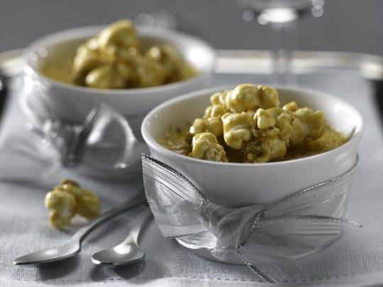 Caramel popcorn is sprinkled over crèmes brûlées.