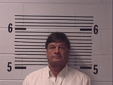 Elmore commissioner arrested on ethics charge