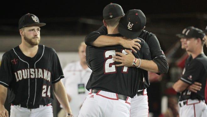 Ragin' Cajuns' Nick Zaunbrecher, #27, hugs Wyatt Marks following the team's 3-1 loss to the Arizona Wildcats in the NCAA Baseball Lafayette Regional championship at Tigue Field June 6, 2016.