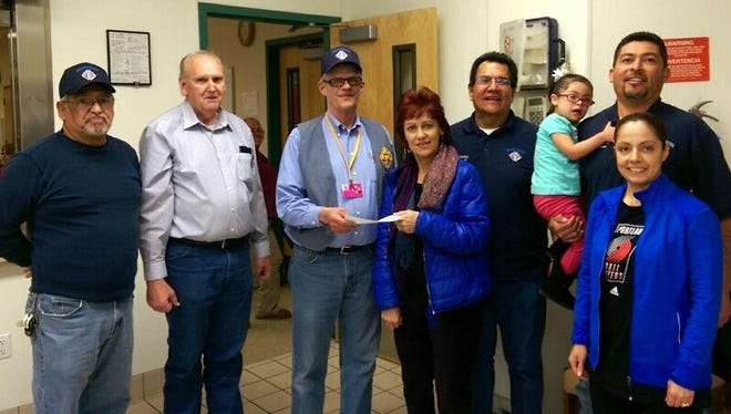 The Knights of Columbus, St. Michael's Council 15062, presented Vicki Garcia with a check donation for the Deming Differently Able group in Deming. The group is associated with the ARC of Silver City. From left, are Knights Fred Loya, Don White, Richard Feaselman, Vicki Garcia, Andy Gonzales, Shanmaree Garcia, Jacob Garcia and Lola Garcia. The donated money will go toward the Deming Differently Able group and its programs.