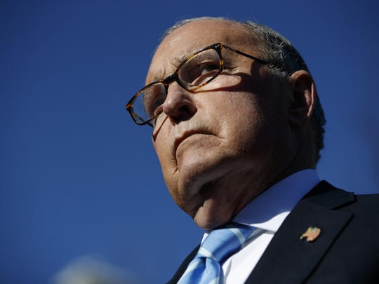 FILE- In this Dec. 3, 2018, file photo White House chief economic adviser Larry Kudlow talks with reporters about trade negotiations with China, at the White House in Washington.