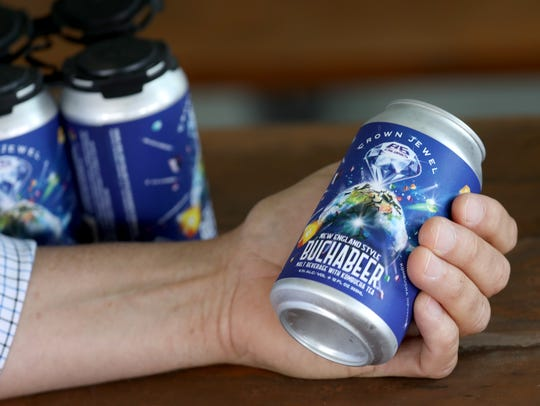 Fairport Brewing owner Tim Garman holds a can of the brewery's buchabeer, a blended kombucha/beer beverage.