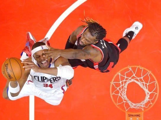 Los Angeles Clippers forward Paul Pierce, left, shoots