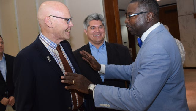 James Carville (left), political operative and educator, speaks with Alexandria Mayor Jacque Roy (center) and the Rev. Larry Turner (right) at the City of Alexandria Rotary Club meeting Tuesday where Carville was a guest speaker for the club's weekly luncheon.