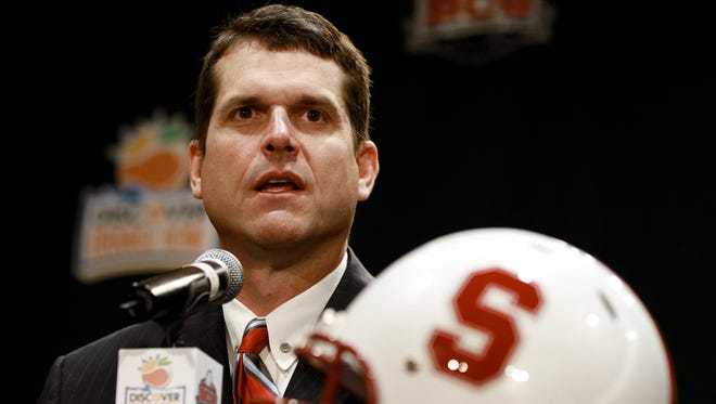 Stanford football coach Jim Harbaugh answers questions Jan. 3, 2010.