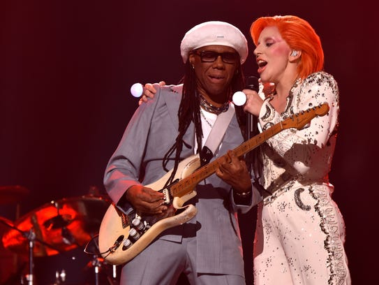 Musician/producer Nile Rodgers (L) and singer Lady