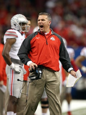 Ohio State Buckeyes head coach Urban Meyer reacts on the sidelines in their game against the Alabama Crimson Tide in the third quarter of the 2015 Sugar Bowl at Mercedes-Benz Superdome.