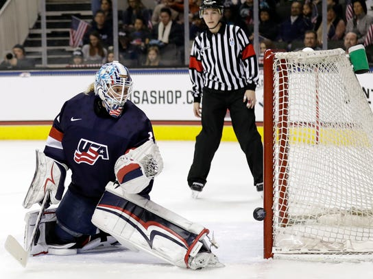 In this Dec. 15, 2017, file photo, United States goalie Alex Rigsby watches as a shot hits the post during the first period of a women's hockey game against Canada in San Jose, California. U.S. goaltenders Maddie Rooney, Nicole Hensley and Alex Rigsby are all Olympic rookies. (AP Photo/Marcio Jose Sanchez)