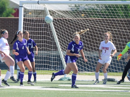 Wylie defender Blayre O'Donald (9) heads a ball clear