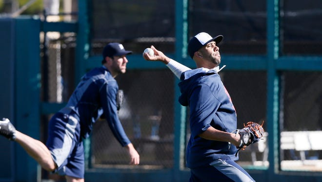 Tigers pitcher Justin Verlander, left, and David Price throwing long ball catch during a morning workout in the outfield at Joker Marchant Stadium at  Spring Training on Wednesday.