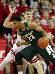 Michigan State's Deyonta Davis drives the ball to score against Wisconsin's Alex Illikainen (25) Sunday in Madison. Davis finished with seven points in 19 minutes.