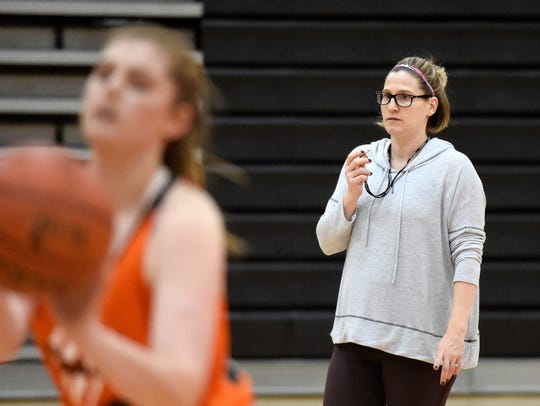Head coach Marly Manlove looks on as the Palmyra's
