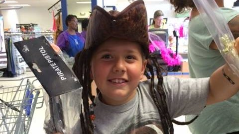 A prospective pirate checks out the selection at Goodwill's Concord location.