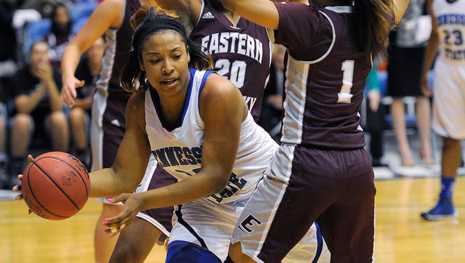 Chelsea Hudson looks for a teammate to pass to as Tennessee State University plays Eastern Kentucky in the OVC tournament at Municipal Auditorium  Thursday March 6, 2014, in Nashville, TN.