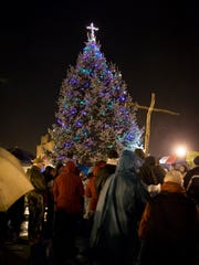 An ACLU lawsuit asks that the cross be removed from the top of the town Christmas tree in Knightstown.