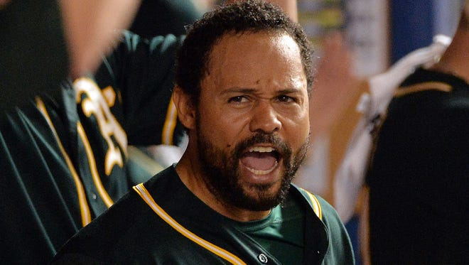 Oakland Athletics center fielder Coco Crisp (4) reacts in the dugout after having his call over turned during the ninth inning against the Miami Marlins at Marlins Ballpark.