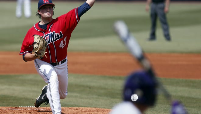 Mississippi pitcher Christian Trent (47) throws to a Washlngton batter in the first inning of an NCAA college baseball regional tournament game in Oxford, Miss., Sunday, June 1, 2014. (AP Photo/Rogelio V. Solis)