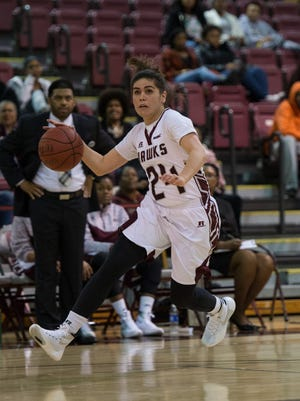 UMES guard, Moengaroa Subritzky (24) drives the ball to the net during a game against UMBC in Princess Anne on Tuesday Dec. 16, 2015.