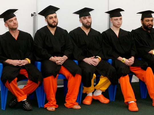 Rutherford County jail inmates (L to R)  Charles Estes, Juan Garcia, Patrick His, Colton James and Troy Smith wait to receive their diploma after passing the HiSET exam and earning a high school equivalency diploma during a graduation ceremony on Nov. 30, 2017, at the Rutherford County Adult Detention Center.
