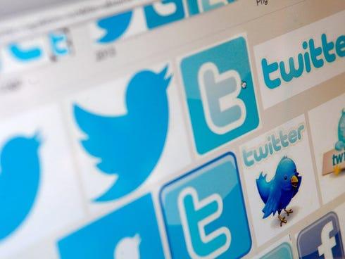 Photo illustration of Twitter logos.