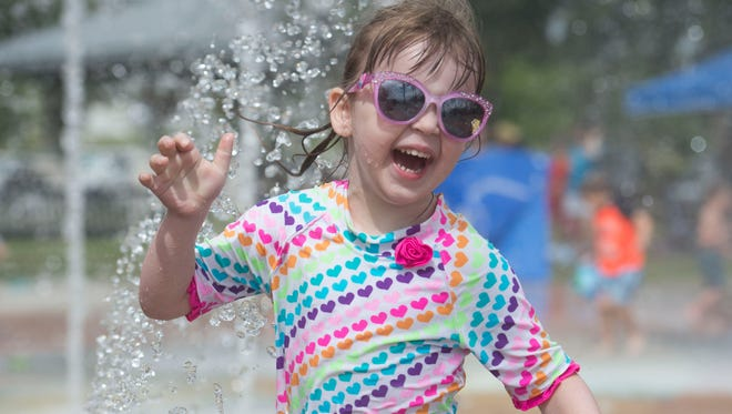 "Elizabeth Comer, 4, of Palm City says ""playing with the toys"" is her favorite part of water activities. One of the Mothers of Preschoolers summer playdates was July 12 at the interactive fountain at Indian RiverSide Park in Jensen Beach."