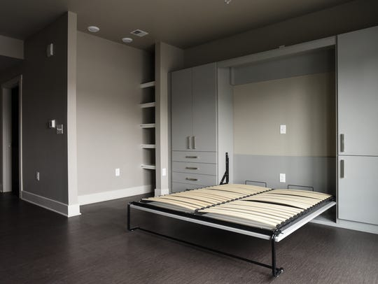 A Murphy bed in on of the Marketplace Apartment studios