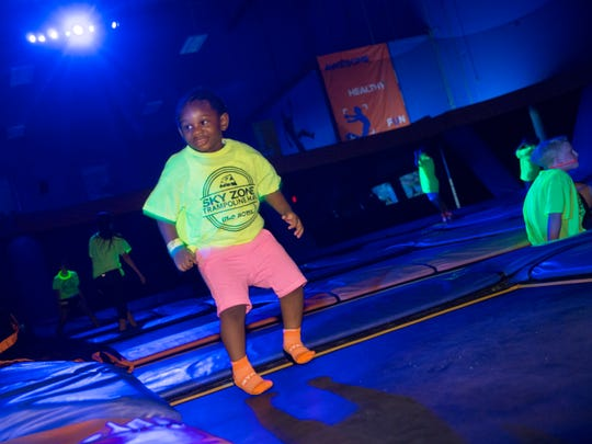 Chikamso Osadebe, 2, of Lakewood, plays on the trampolines during a GLOW session at Sky Zone in Lakewood.