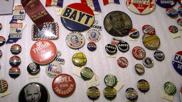 Political buttons from elections past sit in a drawer in a storage area at the Indiana State Museum.