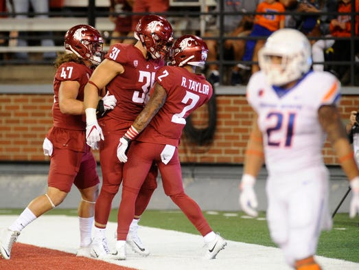 Washington State's defense celebrates a touchdown off