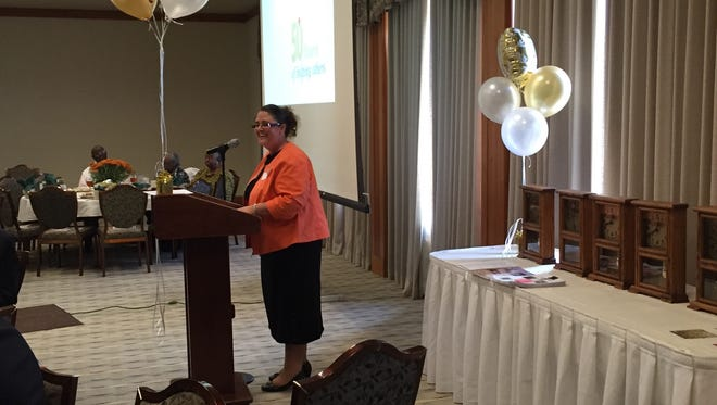 LEADS employee Sherry Day shares memories of the agency Friday during a lunch to celebrate its 50th anniversary.